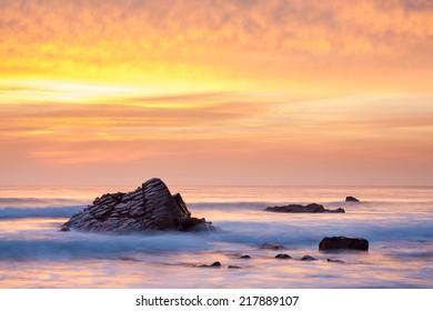 Stunning sunset on the beach at Sandymouth near Bude North Cornwall England UK Europe