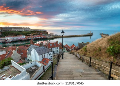 Stunning sunset over the 199 Steps leading down to Whitby harbour on the Yorkshire coast