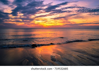 A stunning sunset over the beautiful waters of Koh Lanta, Krabi, Thailand