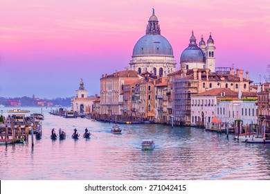 Stunning sunset over Grand Canal and Basilica Santa Maria della Salute in Venice, Italy.