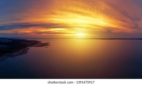 Stunning sunset over the lake, aerial view