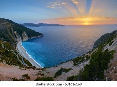 Stunning sunset over Myrtos Beach in Kefalonia island, Greece