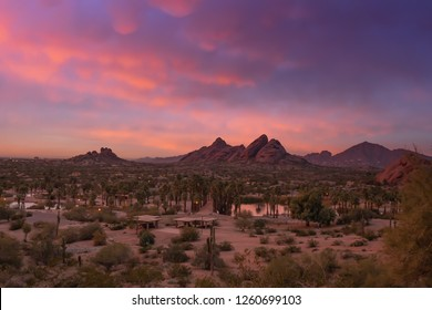 Stunning sunset over Phoenix, Arizona, Papago Park in foreground.
