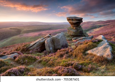 Stunning sunset over the Salt Cellar a weathered rock formation on Derwent Edge high above the Ladybower Reservoir in the Upper Derwent Valley in the Derbyshire Peak District