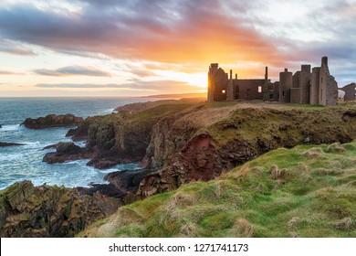 Stunning sunset over Slains Castle near Peterhead on the east coast of Scotland