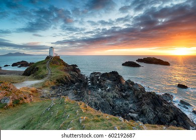 Stunning sunset over the Twr Mawr lighthouse on Ynys Llanddwyn on the Anglesey coast in north Wales