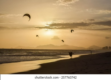 Stunning sunset in Rio de Janeiro with silhouette of kite surfers