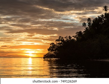 Stunning sunset in the Togian (or Togean) islands in Sulawesi, a remote corner of Indonesia still untouched by pollution in the Celebes sea.