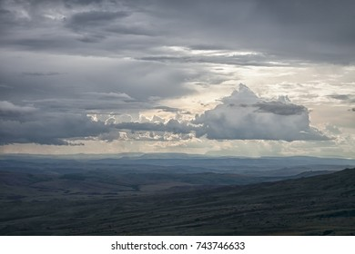 Stunning tragic view to the rainy sky and wild lands beneath it