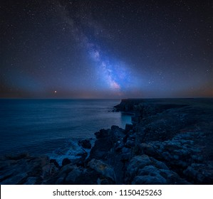 Stunning vibrant Milky Way composite image over landscape of St Govan's Head on Pembrokeshire Coast in Wales