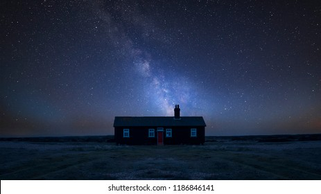 Stunning vibrant Milky Way composite image over landscape of Remote desolate isolated house