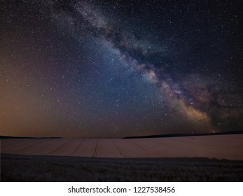 Stunning vibrant Milky Way composite image over landscape of wheat field in Summer