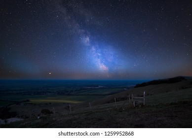 Stunning vibrant Milky Way composite image over landscape of countryside in Summer