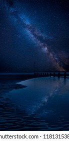 Stunning vibrant Milky Way image over landscape of Beautiful long exposure beach