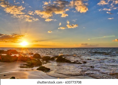 Stunning and vibrant sunset at Big Beach, in Makena State Park, in Maui Hawaii