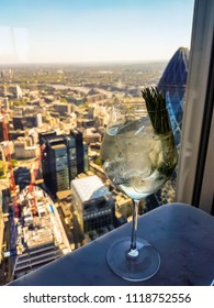 Stunning view across London, with a gin and tonic in the foreground