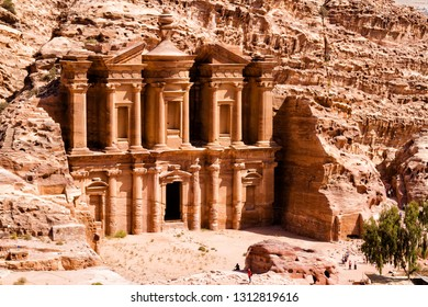 The stunning view of Ad Deir, the Monastery of Petra, Jordan on a clean blue sky day.