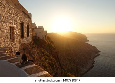 Stunning view to the Aegean blue sea from picturesque chora of Folegandros island at sunset, Cyclades, Greece