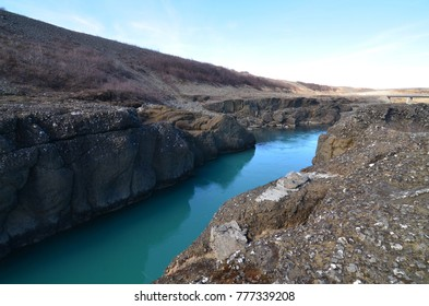 Stunning view of a blue river flowing through rocks
