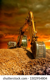 Stunning view at crawler excavator during earthmoving works on construction site at sunset