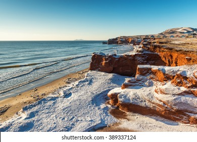 Stunning view of Dune du Sud red cliffs during a winter sunrise on Havre-aux-Maisons Islands, Quebec, Canada