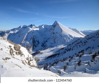 Stunning view of an elegant mountain peak (M. Francais Pelouxe, 2736 m) in winter time. Location: italian Alps, Torino Province.