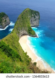 stunning view of the famous Kelingking beach with steep cliffs in Nusa Penida, just off the coast of Bali in Indonesia. The island is getting very popular due to dramatic coastal landscapes.