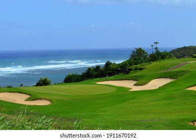 A stunning view of a golf course along the shores of the Pacific ocean in Hawaii