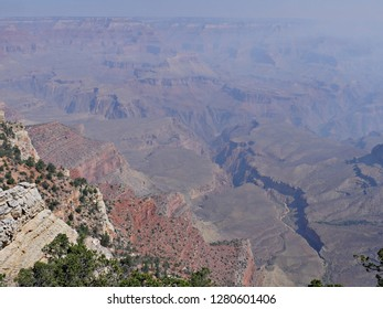 Stunning view of the Grand Canyon National Park on a hazy day from wildfire smoke.