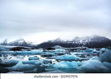 Stunning view of iceberg in glacier lagoon and the beautiful background of giant mountain, Jokulsarlon, Iceland