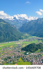 Stunning view of Interlaken and adjacent mountain ridges from the top of Harder Kulm, Switzerland. Famous mountains Eiger, Monch and Jungfrau in background. Swiss Alps. Summer Alpine landscape