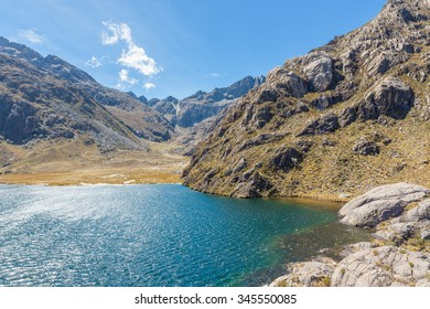 """Stunning view of """"Laguna Verde"""" lake in the Sierra Nevada National Park, in Merida, Venezuela. The lake is located at 4000 masl, on the path to the Humboldt Peak, Venezuela's second highest mountain."""