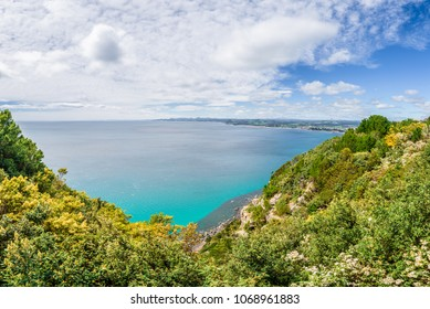 Stunning view from northern cape to rocks mountains green hills and blue turquoise water beach bay grass lands on sunny warm day with few clouds blue sky, Wynyard, North-West, Tasmania, Australia
