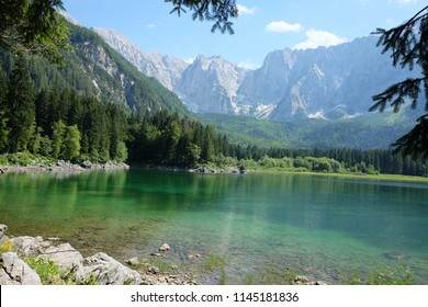 Stunning view on alpine lake Lago Di Fusine in Italy