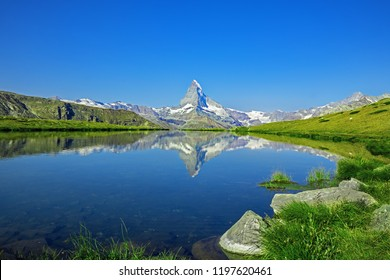 Stunning view on mountain Matterhorn at morning reflection in beautiful alpine lake, Stellisee, Valais region, Switzerland, Europe