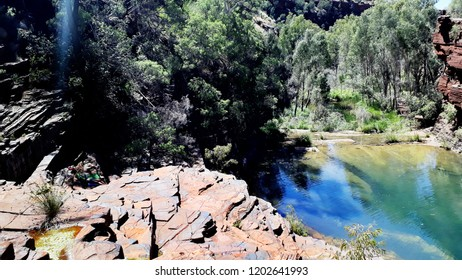 Stunning view on the natural spa and swimming area of the Fortescue Falls in the Karijini National Park, WA