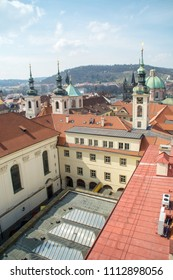 A stunning view on Prague's rooftops from the Klementinum tower terrace