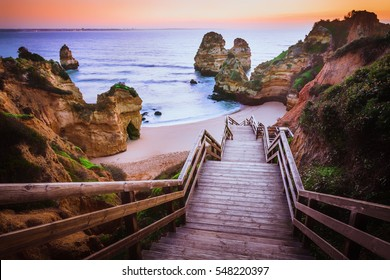 Stunning view over Praia do Camilo in Lagos, Algarve Portugal during the sunrise. Rocks, cliffs and formations in the ocean. Natural treasure.