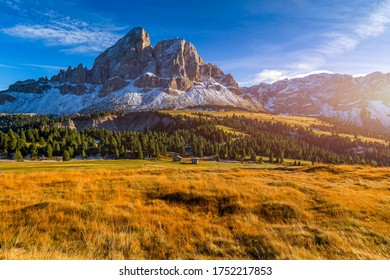 Stunning view of Peitlerkofel mountain from Passo delle Erbe in Dolomites, Italy. View of Sass de Putia (Peitlerkofel) at Passo delle Erbe, with wooden farm houses, Dolomites, South Tyrol, Italy.