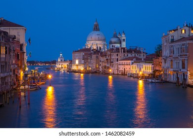 The stunning view from Ponte dell'Accademia taking in the sights of the Grand Canal and Basilica di Santa Maria della Salute in the beautiful city of Venice, Italy.