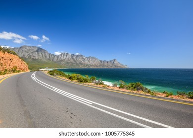Stunning view of Route 44 near Kogel Bay Beach in the eastern part of False Bay near Cape Town between Gordon`s Bay and Pringle Bay. Hottentots Holland Mountain range in the background.