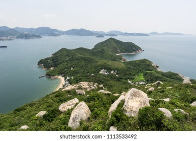 Stunning view of the rugged coastline of Lamma island with Hong Kong island in the background in Hong Kong, China SAR