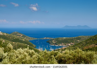 Stunning view of Sivota village and it's bay - Lefkada island in Greece. In front are the olive trees and in distance is Atokos island.