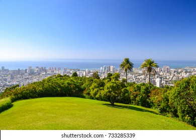 Stunning view of the skyline of Honolulu with the beachfront neighborhood Waikiki on the island of Oahu, Hawaii, USA. Seen from a lookout at Tantalus, a volcanic cinder cone mountain behind Honolulu.