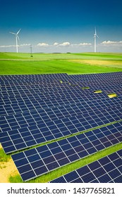 Stunning view of solar panels on green field, aerial view