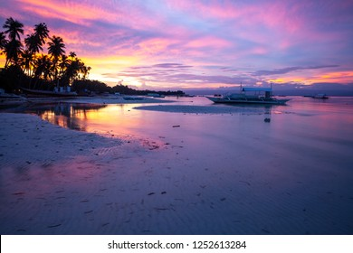 Stunning view of the sunset on the Philippine beach. Doljo beach, Panglao, Bohol, Philippines.