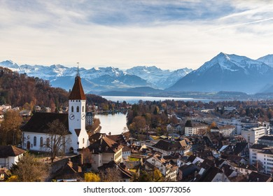 Stunning view of the Thun city and lake of Thun from the Thun castle with the snow covered peaks of Alps in background, Canton of Bern, Switzerland