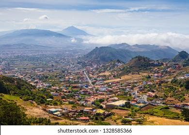 Stunning view of the volcano Teide and the city of San Cristóbal de La Laguna from the viewpoint Mirador De Jardina. Tenerife. Canary Islands.Spain