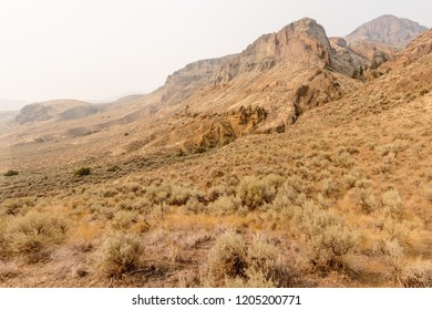 Stunning views of hoodoos and forest fire smoke at Cinnamon Ridge, Kamloops, British Columbia, Canada