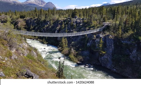 Stunning views over the white-water rapids of the Tutshi River from the Yukon Suspension Bridge in Canada near Skagway Alaska
